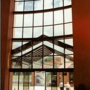 Porta telescópica de vidro
